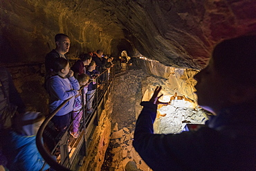 Tourists inside Aillwee Cave, The Burren, County Clare, Munster, Republic of Ireland, Europe