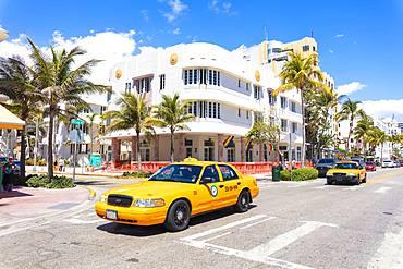 Yellow taxi cab, Ocean Drive, Miami Beach, Florida, United States of America, North America
