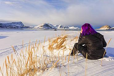 Woman on Haukland Beach covered with snow, Leknes, Vestvagoy, Lofoten Islands, Nordland, Norway, Europe