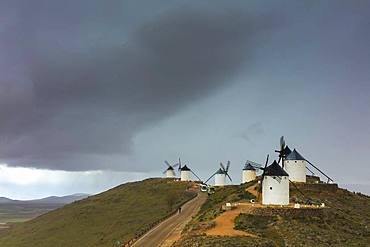 Storm clouds on windmills of Consuegra, Don Quixote route, Toledo province, Castilla-La Mancha (New Castile) region, Spain, Europe