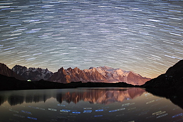 Star trail over Mont Blanc range seen from Lac des Cheserys, Parc Aiguilles Rouges, Haute Savoie, French Alps, France, Europe