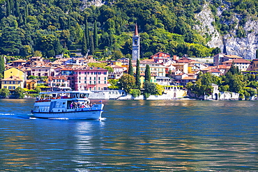 People on boat trip around the village of Varenna, Lake Como, Lecco province, Lombardy, Italian Lakes, Italy, Europe