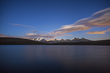 View of Gran Paradiso range at sunset from Lake Rossett (Lago Rossett), Colle del Nivolet, Alpi Graie (Graian Alps), Italy, Europe