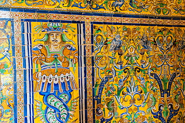 Close-up of ceramic wall of colorful tiles with human figure and allegorical scenes, Real Alcazar, UNESCO World Heritage Site, Seville, Andalusia, Spain, Europe