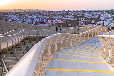 People on curved walkways admire the city skyline, Metropol Parasol, Plaza de la Encarnacion, Seville, Andalusia, Spain, Europe