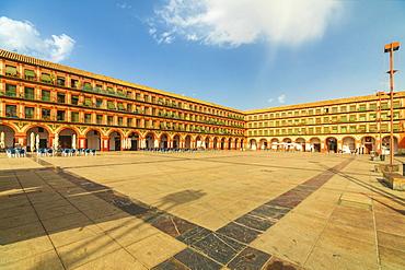 Orange colored buildings and arcades of Plaza de la Corredera (Corredera Square), the main square of Cordoba, Andalusia, Spain, Europe