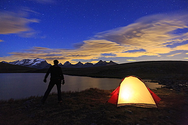 Camping under the stars on Rosset Lake at an altitude of 2709 meters, Gran Paradiso National Park, Alpi Graie (Graian Alps), Italy, Europe