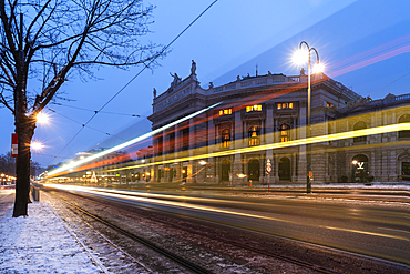 Lights of car trails on the icy road beside the famous Burgtheater (Austrian National Theatre), Vienna, Austria, Europe