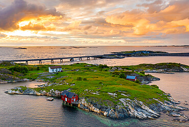 Sunset over the traditional houses of fishermen on islets along the Atlantic Road, More og Romsdal county, Norway (drone)