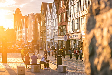 Tourists in Bryggen Old Town at sunset, UNESCO World Heritage Site, Bergen, Hordaland County, Norway, Scandinavia, Europe
