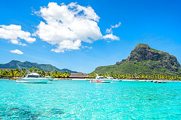 Boats in the turquoise sea surrounding the white sand beach, Le Morne Brabant, Black River district, Mauritius, Indian Ocean, Africa