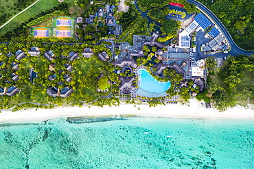 Aerial view by drone of luxury tourist resort on palm-fringed beach facing the tropical lagoon, Le Morne Brabant, Mauritius, Indian Ocean, Africa