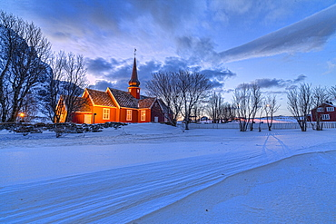 The red church of Flakstad surrounded by snow at dusk, Lofoten Islands, Arctic, Norway, Scandinavia, Europe