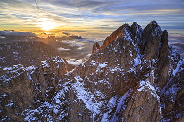 Aerial shot of Sassolungo at sunset, Sella Group, Val Gardena in the Dolomites, Val Funes, Trentino-Alto Adige South Tyrol, Italy, Europe