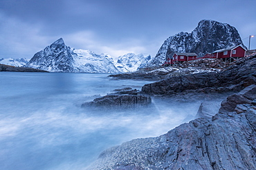 Dusk light on the typical red houses and rough sea, Hamnoy, Lofoten Islands, Northern Norway, Scandinavia, Arctic, Europe