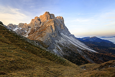 Dawn illuminates the peaks of Forcella De Furcia, Funes Valley, South Tyrol, Dolomites, Italy, Europe