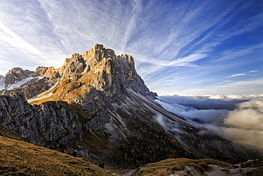 Low clouds and dawn lights on the peaks of Forcella De Furcia, Funes Valley, South Tyrol, Dolomites, Italy, Europe