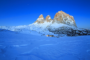 The blue dusk on Sassopiatto and Sassolungo, Fassa Valley, Sella Pass, Trentino-Alto Adige, Dolomites, Italy, Europe