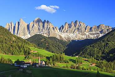 The village of St. Magdalene surrounded by green meadows at the foot of the Odle, Funes Valley, South Tyrol, Dolomites, Italy, Europe