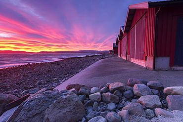The colors of dawn light up the houses of fishermen, Arland Brekstad, Trondelag, Norway, Scandinavia, Europe