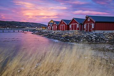 The colors of dawn light up the houses of fishermen, Flatanger, Trondelag, Norway, Scandinavia, Europe