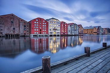 The lights of the houses reflected in the River Nidelva, Bakklandet, Trondheim, Norway, Scandinavia, Europe