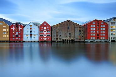Colorful houses reflected in the River Nidelva, Bakklandet, Trondheim, Norway, Scandinavia, Europe