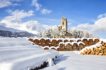 The church of San Gian surrounded by snowy woods, Celerina, Engadine, Canton of Grisons (Graubunden), Switzerland, Europe