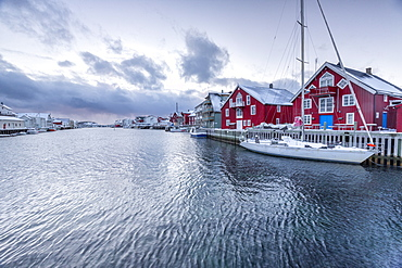 The typical fishing village of Henningsvaer with its red houses (rorbu), Lofoten Islands, Arctic, Northern Norway, Scandinavia, Europe