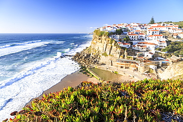 Top view of the village of Azenhas do Mar with the ocean waves crashing on the cliffs, Sintra, Portugal, Europe