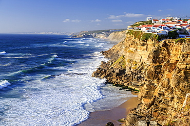 Top view of ocean waves crashing on the high cliffs of Azenhas do Mar, Sintra, Portugal, Europe