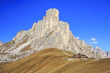 Autumnal view of the high rocky peak of Ra Gusela from Falzarego Pass, Dolomites of Belluno, Trentino-Alto Adige, Italy, Europe