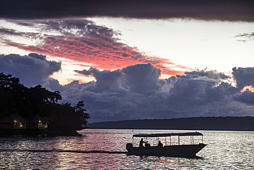 Tourist boat driving back home at sunset in Port Vila, Efate, Vanuatu, Pacific