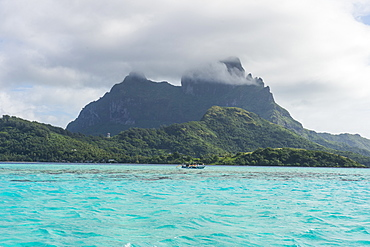 The volcanic rock in the turquoise lagoon of Bora Bora, Society Islands, French Polynesia, Pacific