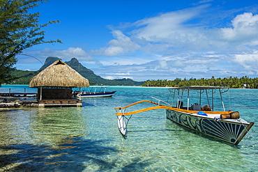 Little boat anchoring on a small Motu, Bora Bora, Society Islands, French Polynesia, Pacific