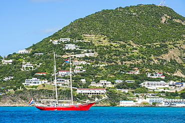 Red sailing boat in the bay of Philipsburg, Sint Maarten, West Indies, Caribbean, Central America