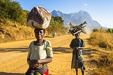 Local women carrying their goods on their heads in front of Mount Mulanje, Malawi, Africa