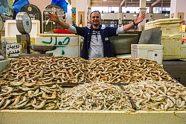 Local fisher man showing his fish, Fishing market, Kuwait City, Kuwait, Middle East