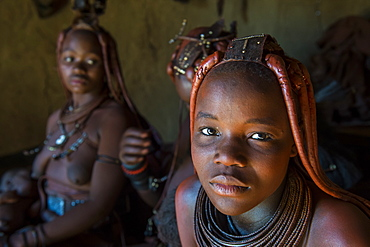 Friendly Himba women in their hut, Kaokoland, Namibia, Africa