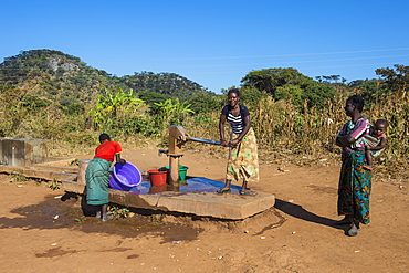 Local women at a water well, Malawi, Africa