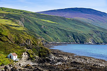 Little cottage on the coast of Isle of Man, crown dependency of the United Kingdom, Europe