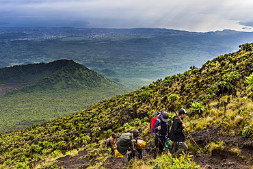 Trekkers on the steep slopes of Mount Nyiragongo, Virunga National Park, Democratic Republic of the Congo, Africa