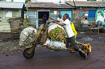 Local man transporting their goods on self made carriers, Goma, Democratic Republic of the Congo, Africa