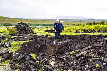 Blocks of peat cut out on a traditional farm, Connemara National Park, County Galway, Connacht, Republic of Ireland, Europe