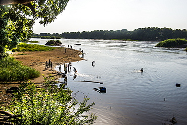 Local people playing in the waters of the White Nile River, Juba, South Sudan, Africa