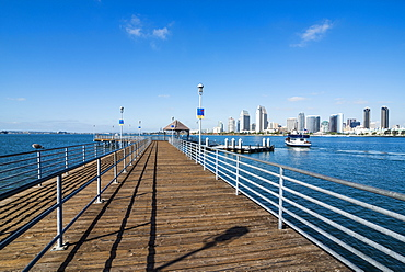Boat pier in front of the skyline of San Diego, California, United States of America, North America