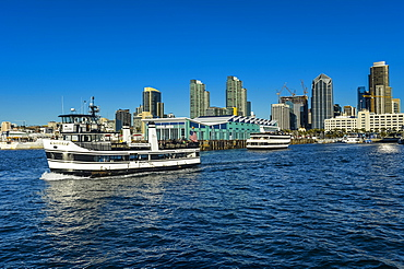 Little tourist cruise ship with the skyline in the background, Harbour of San Diego, California, United States of America, North America