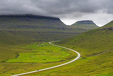 Long winding road through the Fjordland of Estuyroy, Faroe Islands, Denmark, Europe