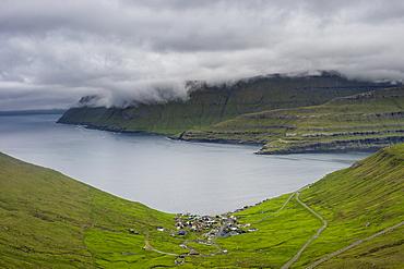 Little village of Funnigur in a huge fjord, Estuyroy, Faroe Islands, Denmark, Europe