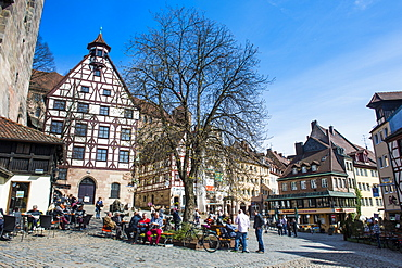Half timbered houses and open air cafes on Albrecht Duerer square in the medieval town center of the town of Nuremberg, Bavaria, Germany, Europe